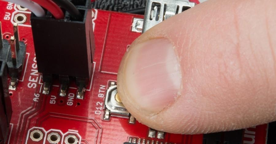 Tlačítko na Arduino robotovi RedBot